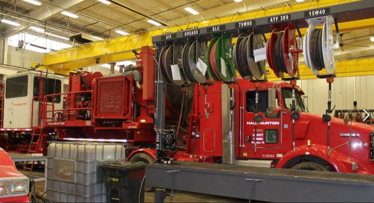 red haliburton truck and equipment in service bay